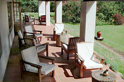 Enjoy a coffee on the veranda of the Ngare Sero Mountain Lodge
