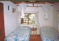 Bedroom of one of the Cottages of Sand Island Beach Cottages in Tiwi