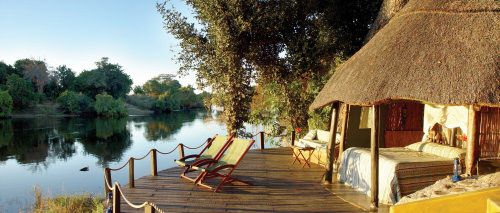 View of the majestic Zambezi River from the open plan cottages at the Tongabezi Lodge